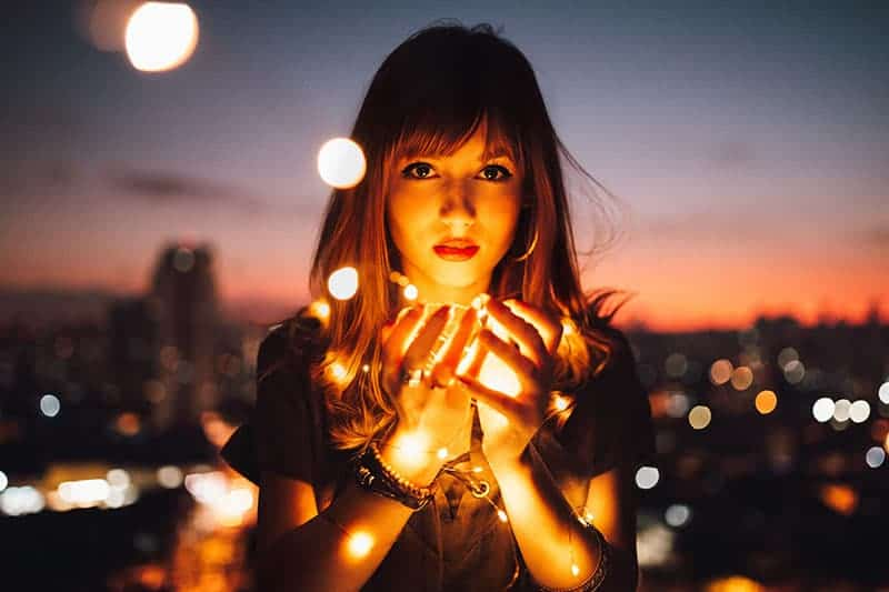 woman holding light in hands