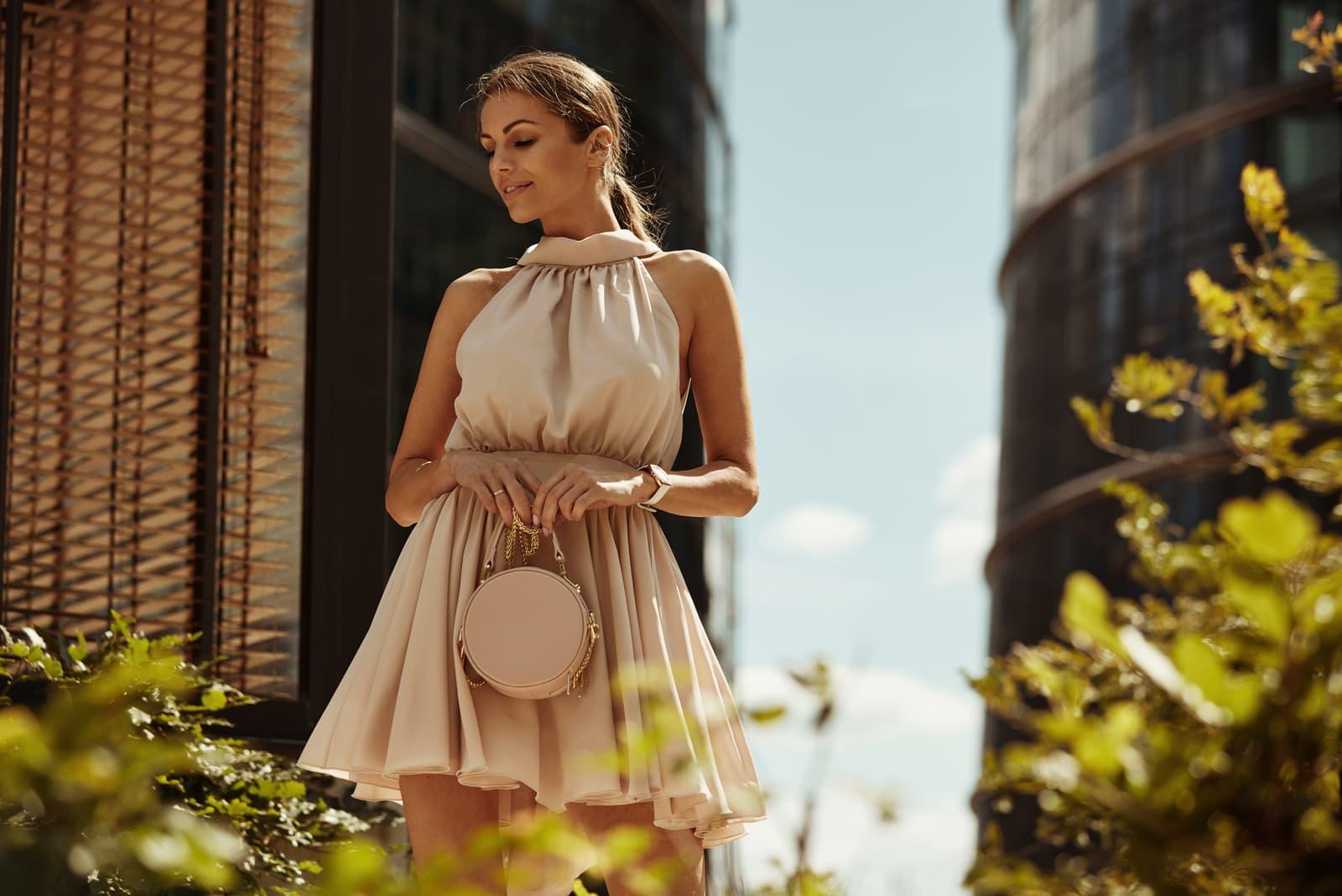 woman with small handbag wear summer dress
