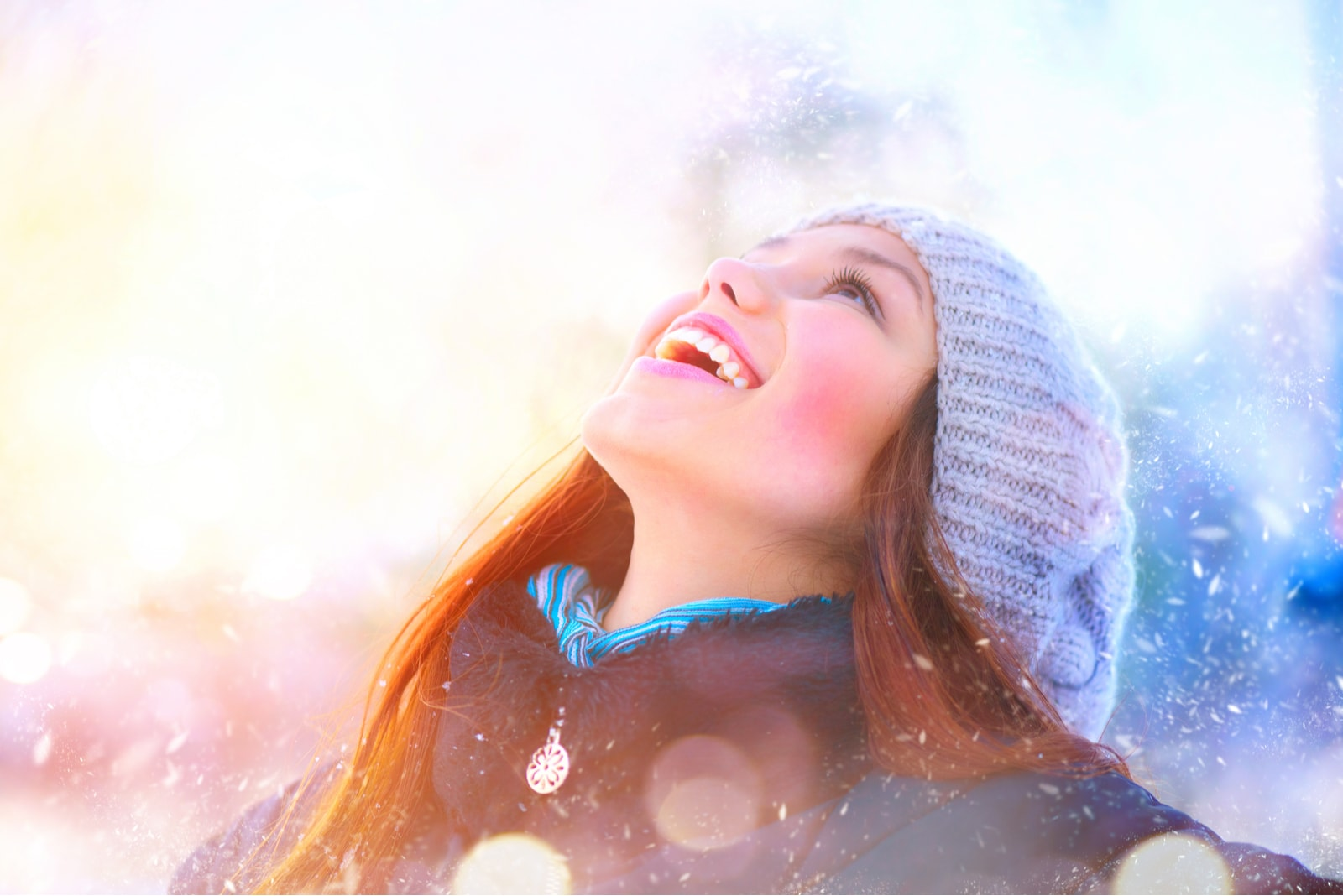 portrait of a smiling woman in the snow