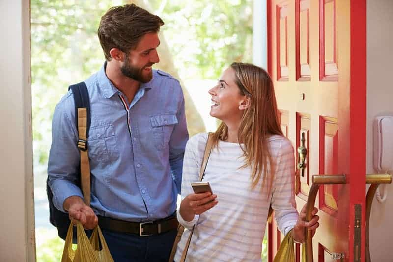 Young Woman Couple Home For Work With Shopping