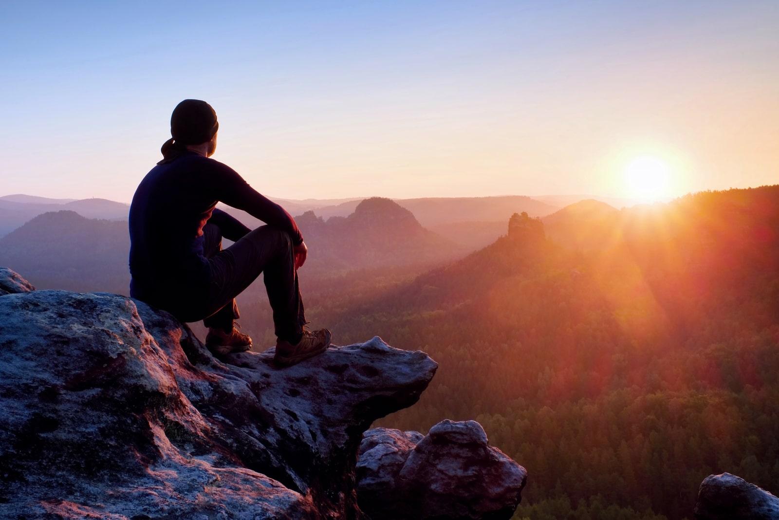 a man sitting on a rock