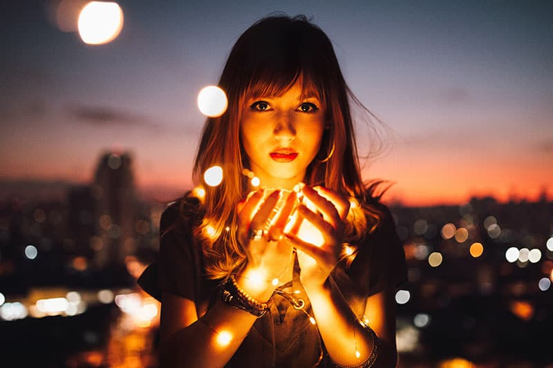 man with lights in her hands