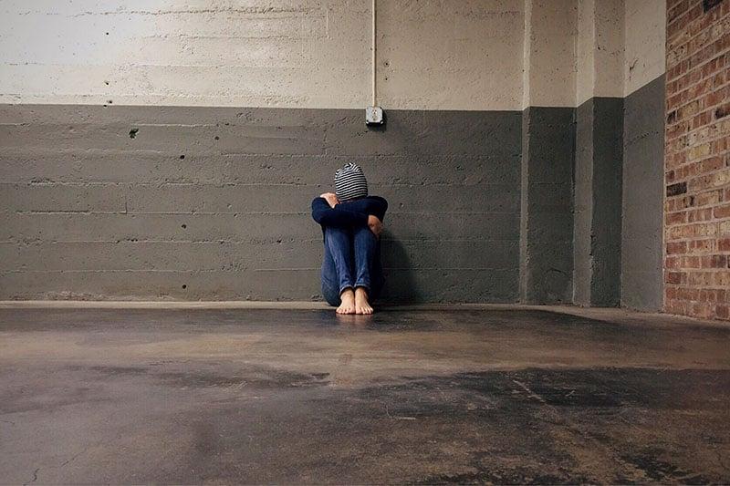 sad woman on the floor