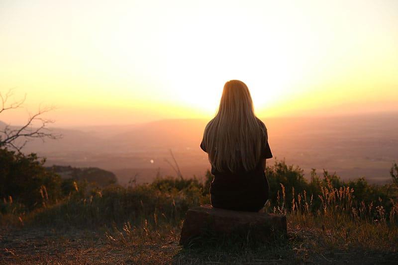 sad woman on a mountain