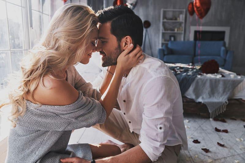 beautiful blond woman cuddling with man