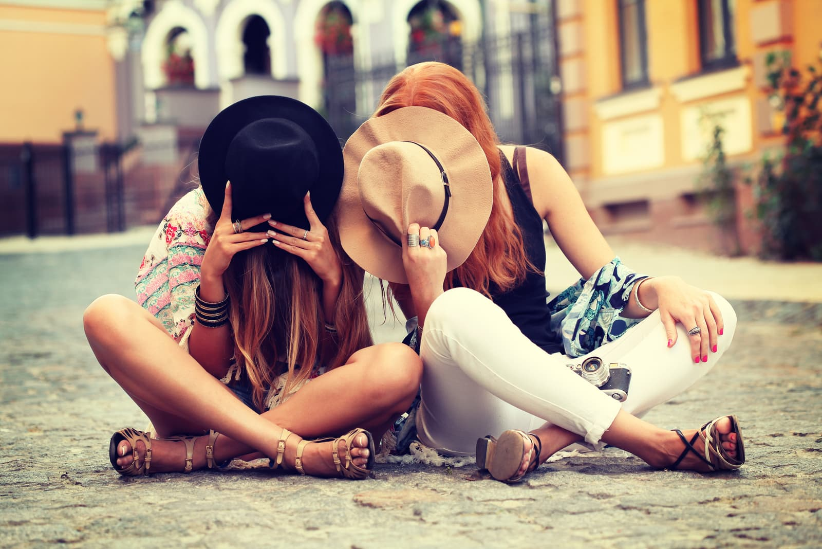 best friends sit on the street and have fun