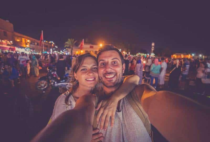 couple taking selfie outside