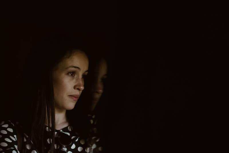 dark photo of sad woman