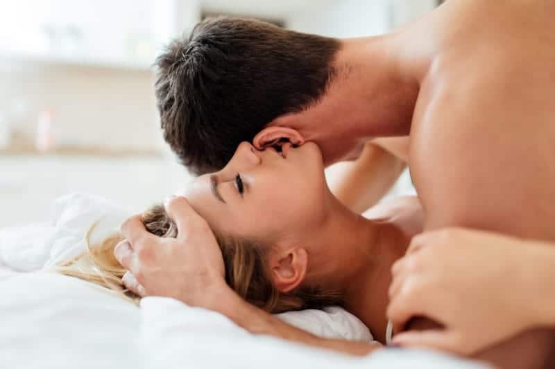 girl whispering on man ear