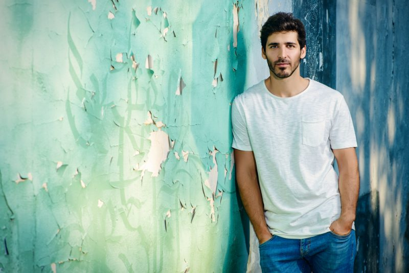 handsome young man in jeans and white t-shirt