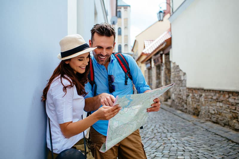 happy couple looking at city map