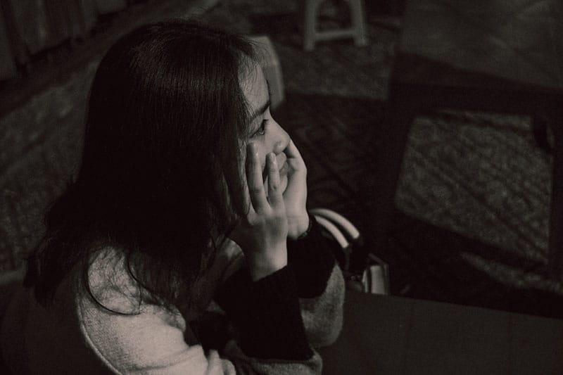 high angle of sad woman