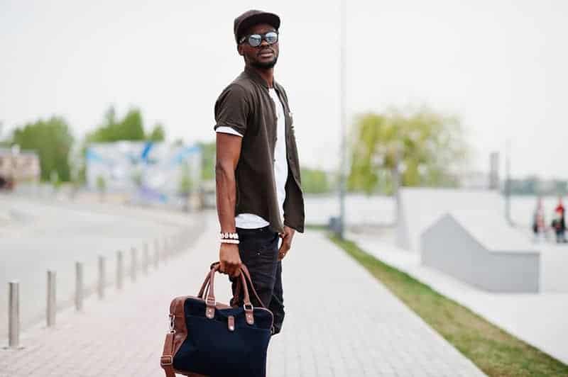 man holding a bag outside