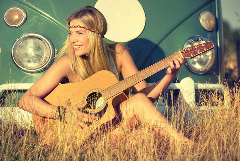 nice blond woman playing a guitar