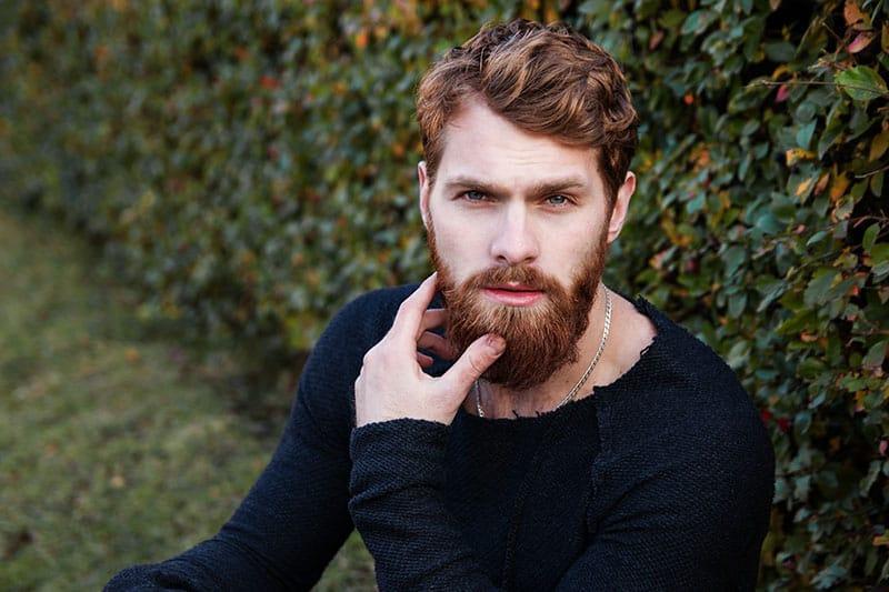 portrait of bearded man standing outside