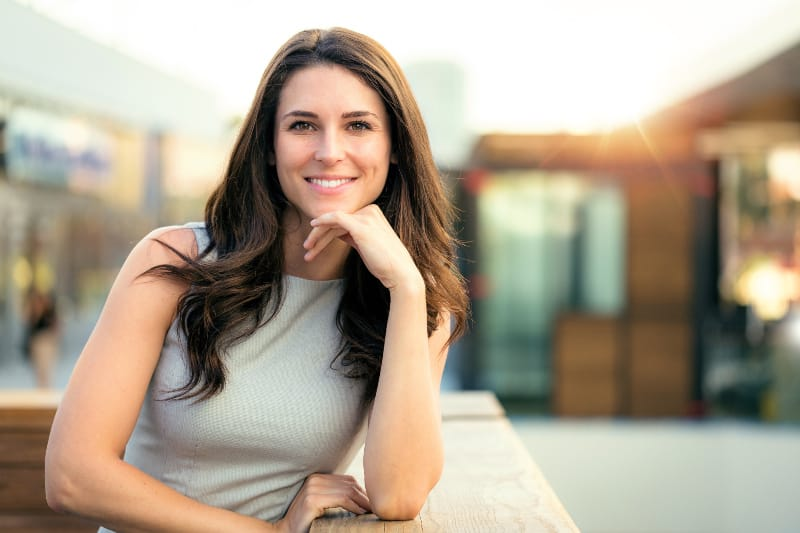 portrait of beautiful woman posing for photo outside