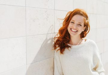 red haired woman outside