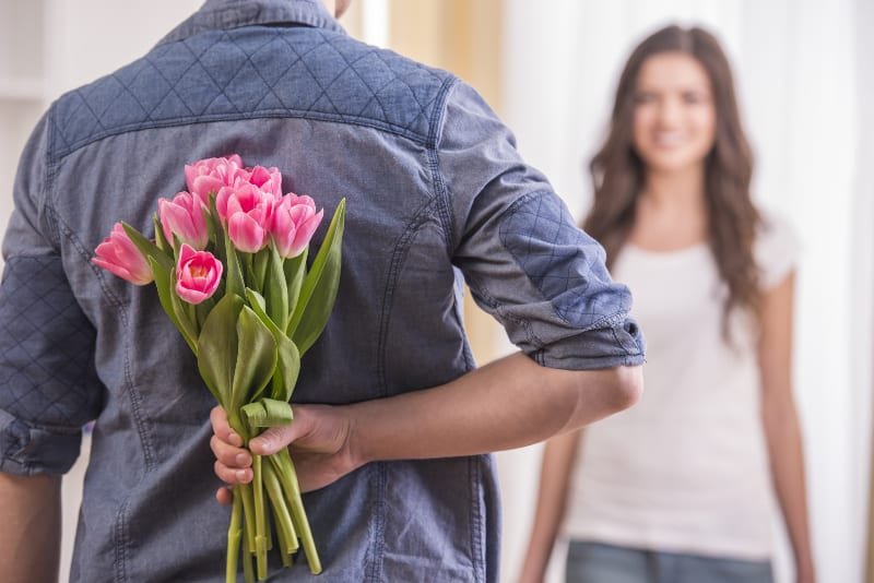 man giving flowers to his woman