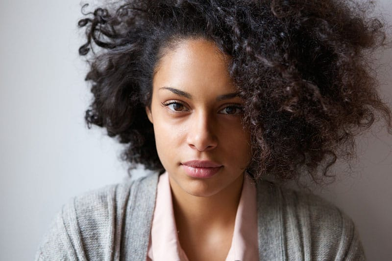 Close up portrait of an attractive young african american woman looking at camera