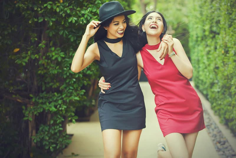 Best friends taking a walk together in outdoor park. friendship and fun time concept in vintage tone