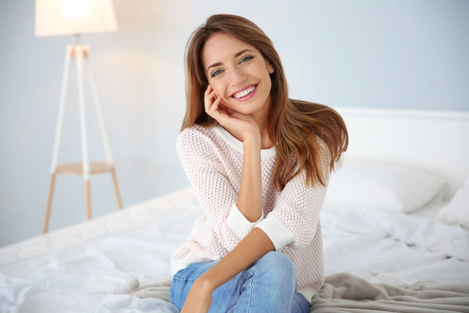 smiling woman posing on the bed