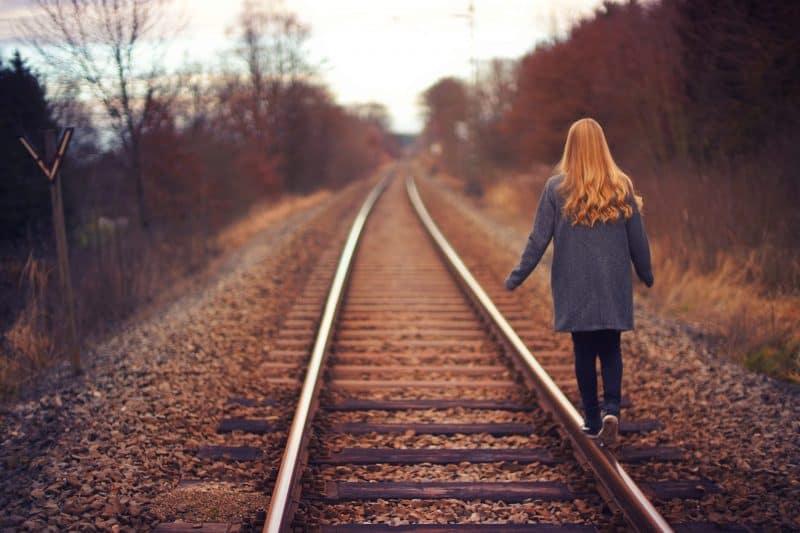woman walking down the railway