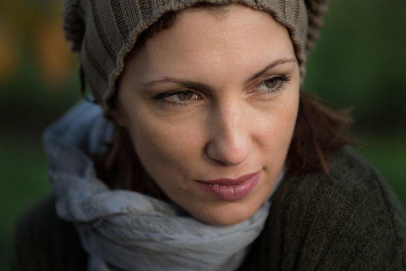 woman with green eyes looking away