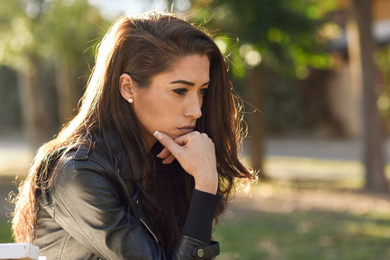 worried young woman staring at one point