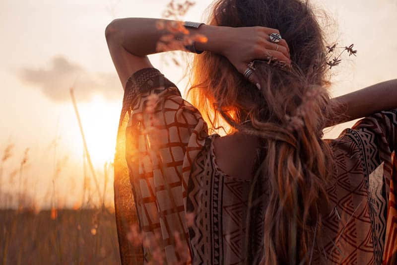 young boho woman enjoying sunset