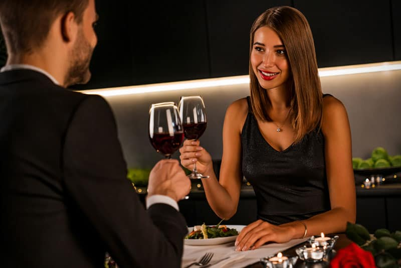 young couple enjoying in romantic dinner