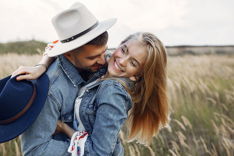 young couple in hug laughing