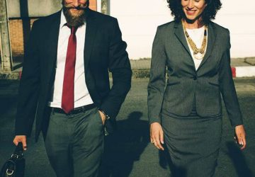 business man and woman walking outside