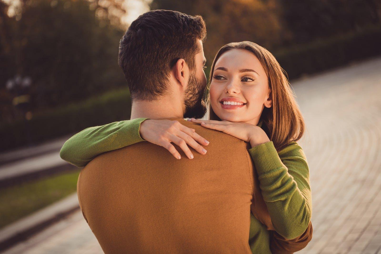 affectionate couple girl hug her boyfriend
