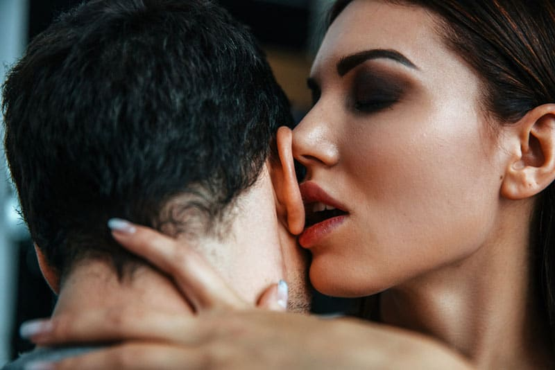 Sensual young couple Portrait. Flirting and kissing
