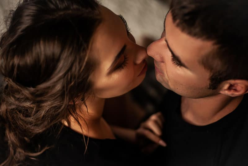 The portrait of sensuality couple kissing in bedroom