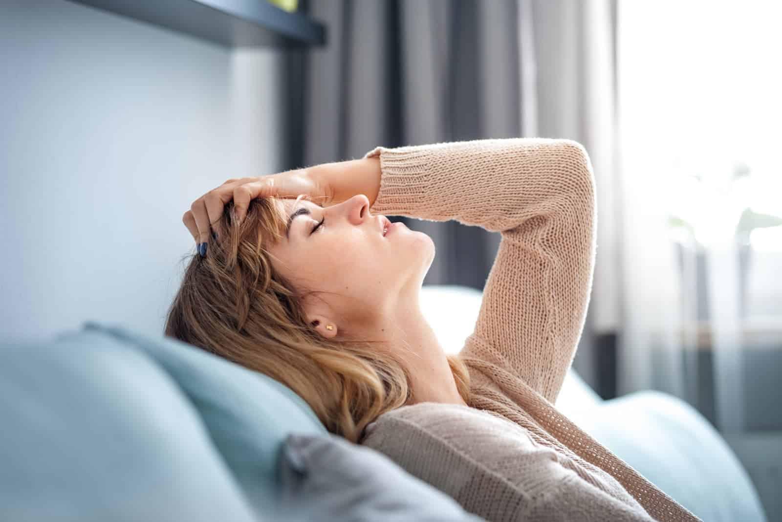 a depressed woman sitting on a sofa