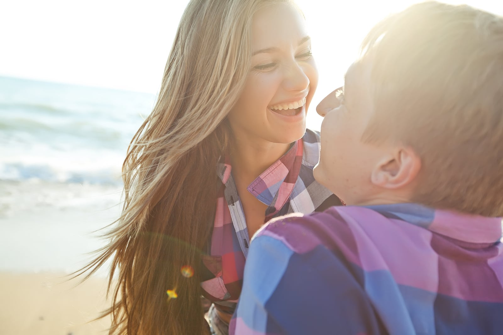 a loving couple having fun on the beach