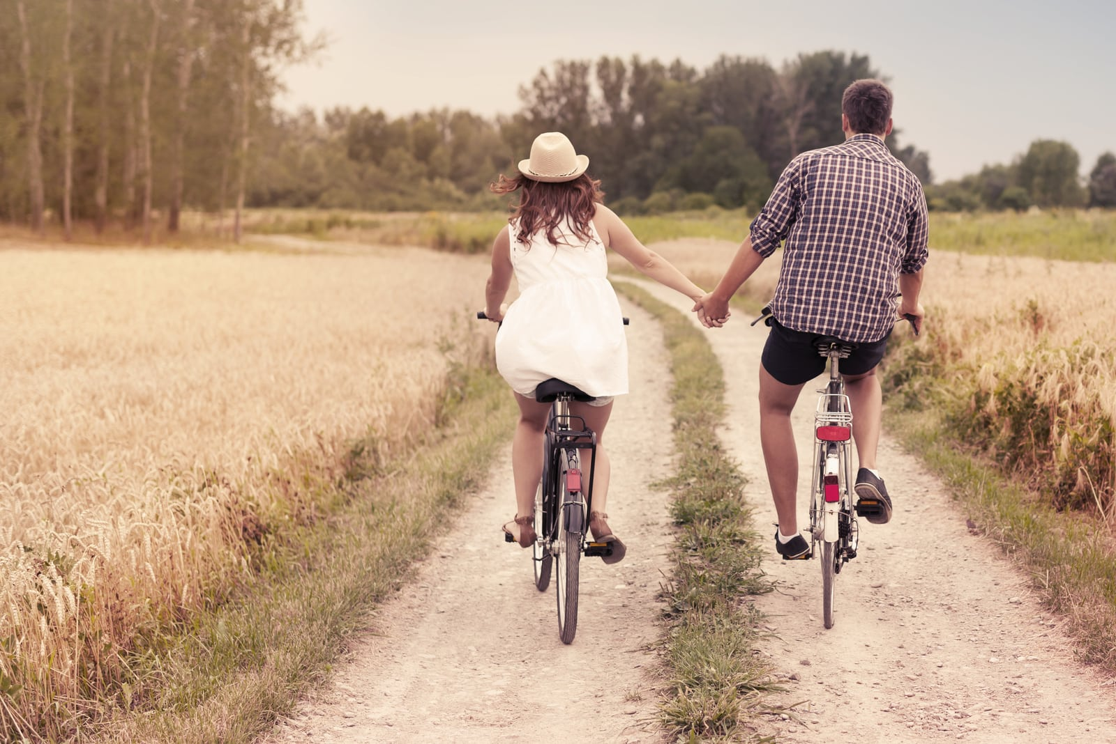 a loving couple rides bicycles