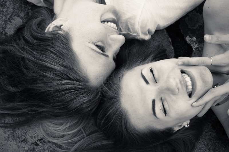 black and white photo of laughing female friends