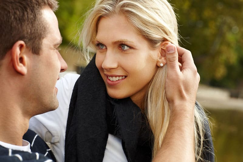blond woman in love with man she lookes at