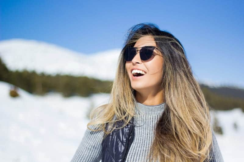 cheerful woman on snow