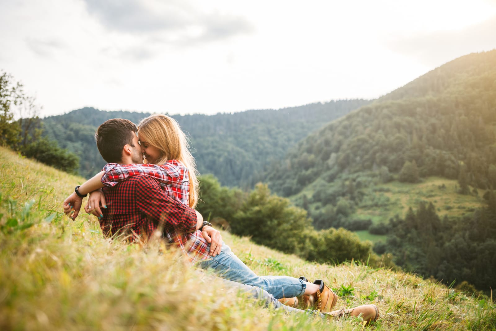 couple lying on the grass and kissing