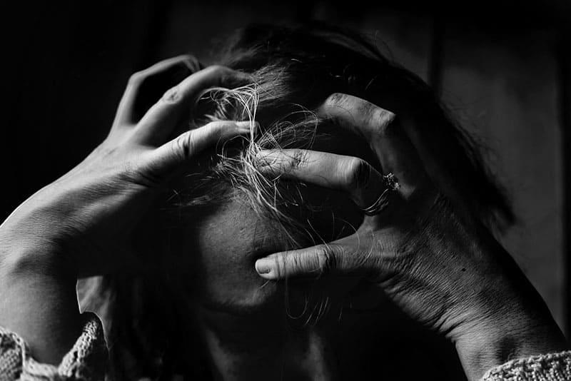 depressed woman grabing for her hair
