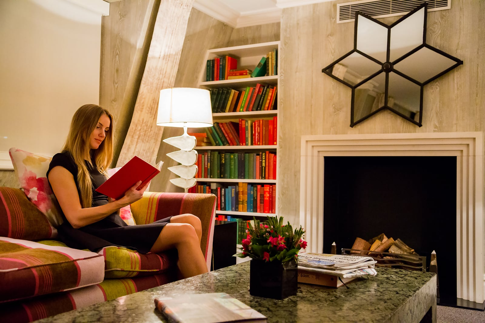girl in a dress sitting in a luxury library room