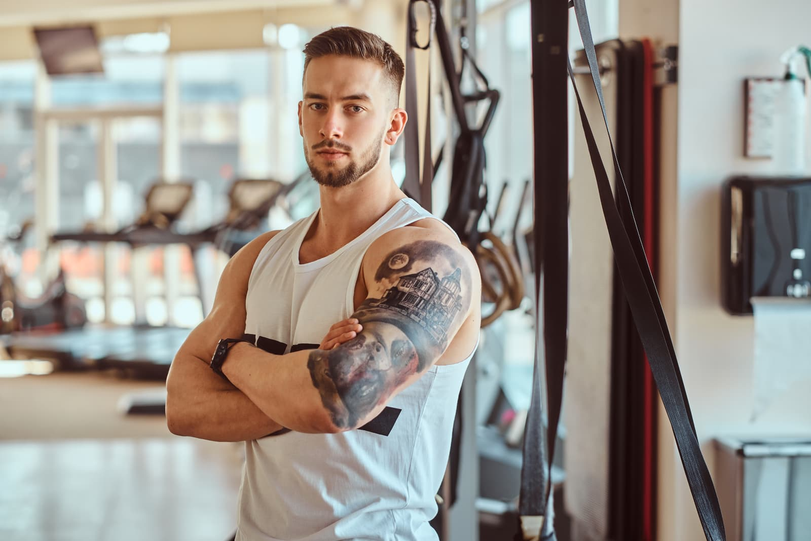 handsome man standing in the gym