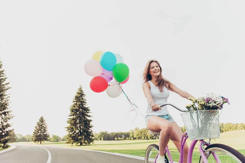 happy woman riding a bike