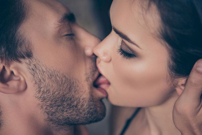 lovely pair of lovers kissing touching neck