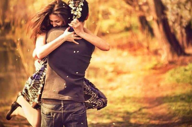 man catching woman in hug