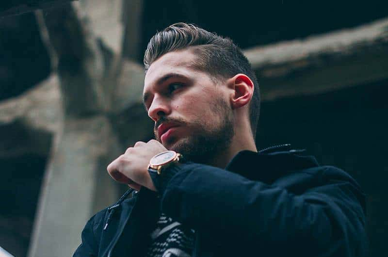man with casual watch and jacket standing outside