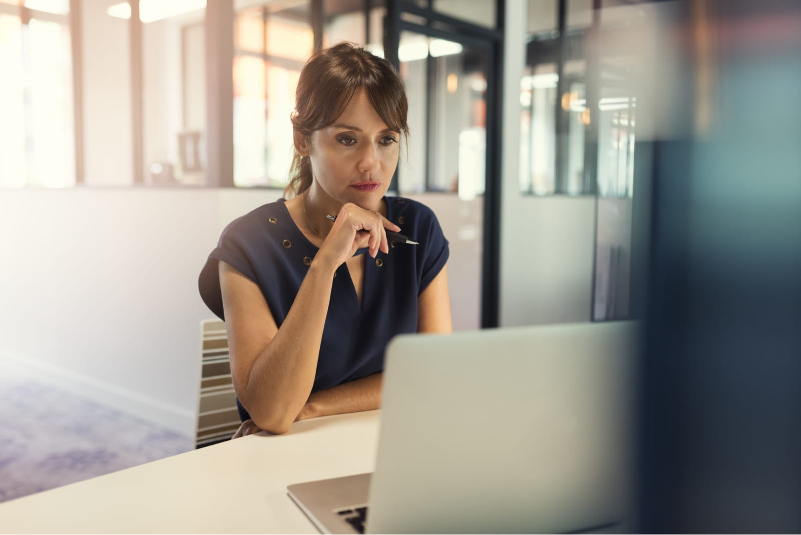 middle aged woman working on her computer